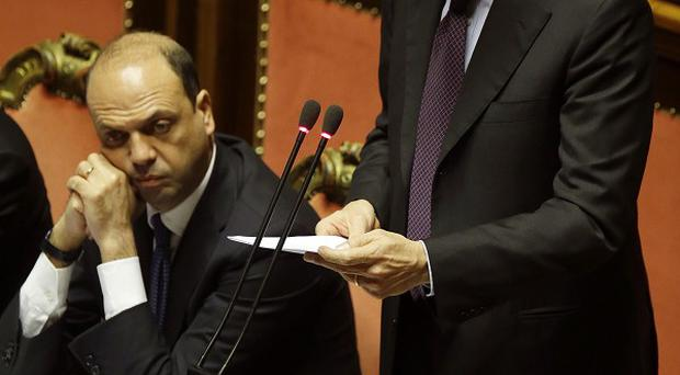 Italian premier Enrico Letta (right) is flanked by interior minister Angelino Alfano as he delivers his message at the Senate prior to the start of a confidence vote at the Senate in Rome (AP)