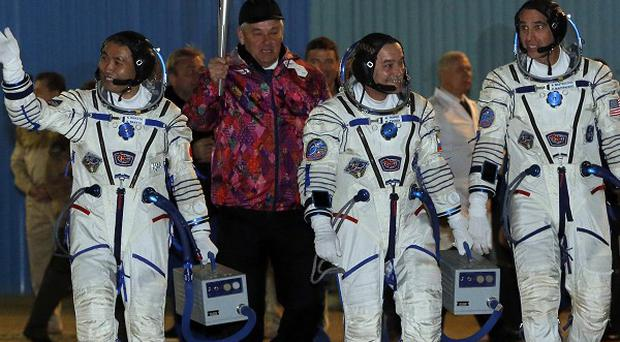 Japanese, Russian and US astronauts setting out for the International Space Station