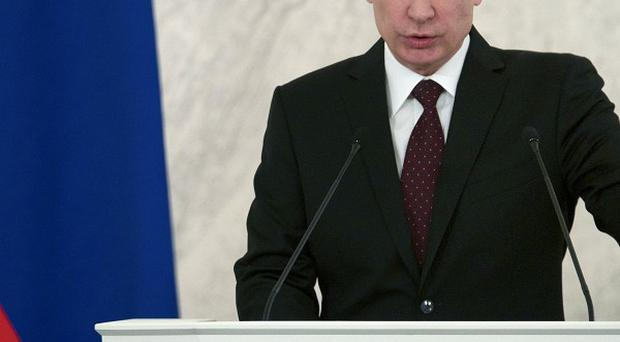 Russian President Vladimir Putin delivering his state-of-the-nation address at the Kremlin (AP)
