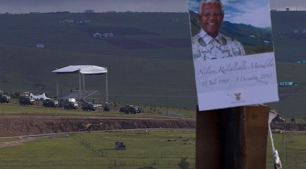 South African army vehicles are parked next to the stage at Nelson Mandela burial site in Qunu, South Africa (AP)