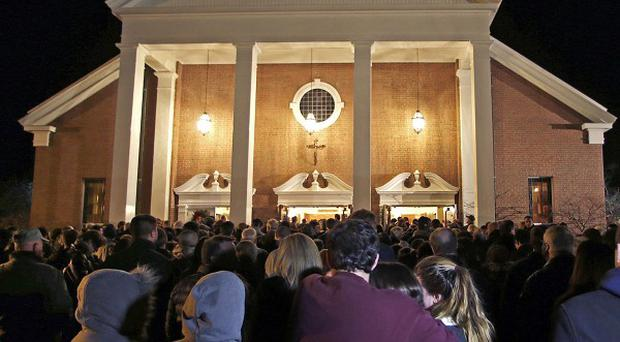 Hundreds of people stand outside St. Rose of Lima Roman Catholic Church in Newtown, Connecticut (AP)