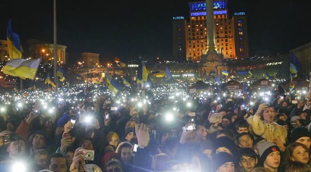 Thousands of fans displaying hand-held torchs as they listen to Okean Elzy during a Pro-European Union rally in the Independence Square in Kiev (AP)