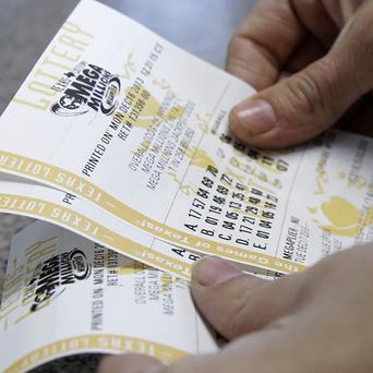 The Mega Millions lottery jackpot has soared to 586 million dollars (£360m) amid a ticket-buying frenzy. (AP)