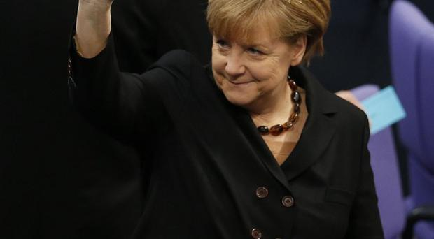 Politicians elected Angela Merkel as Chancellor by 462 votes to 150 with nine abstentions.