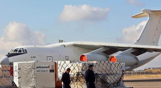 Humanitarian aid is ready to be loaded onto a plane for Syrian refugees (AP)