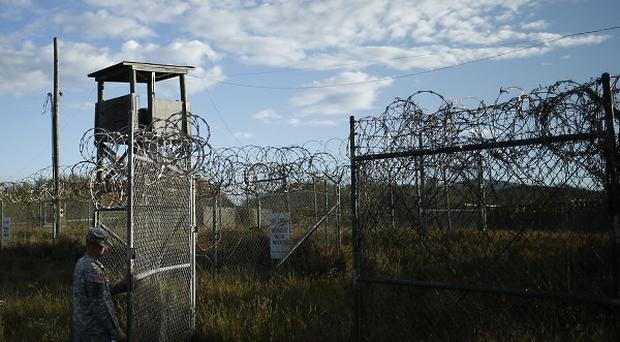 Some Guantanamo Bay inmates may be closer to heading home after a US Congress deal to ease transfer curbs.(AP)