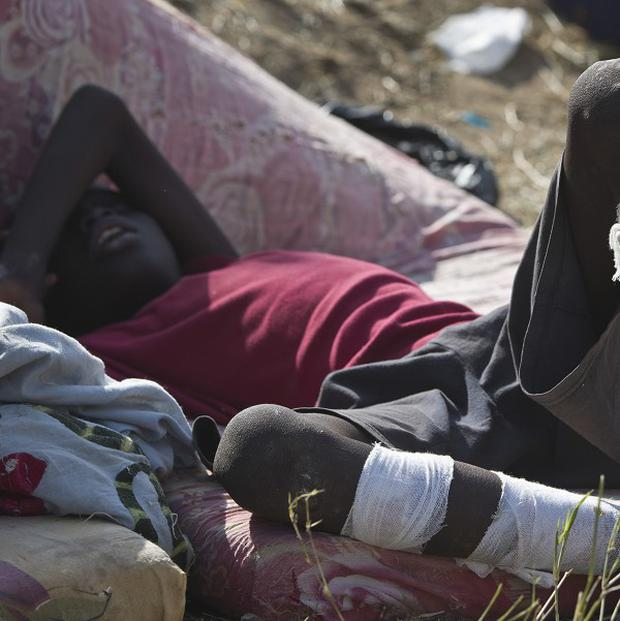 A displaced boy seeks refuge at the compound of the United Nations Mission in South Sudan. (AP)