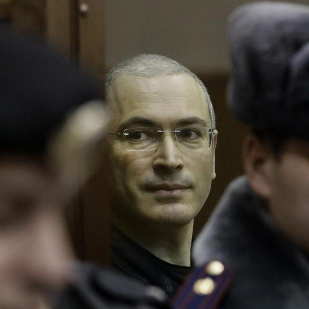 Vladimir Putin has agreed to pardon jailed tycoon Mikhail Khodorkovsky