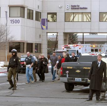 Police escort hospital staff and others from the shooting scene in Reno, Nevada. (AP)