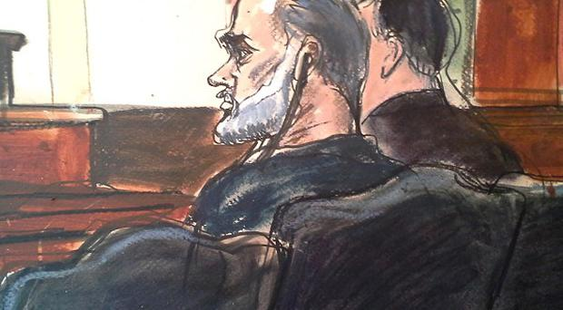 Osama bin Laden's son-in-law, Sulaiman Abu Ghaith, centre, in a sketch made during a court hearing in New York. (AP/Elizabeth Williams)