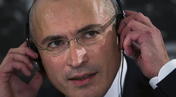 Mikhail Khodorkovsky listens to questions at his first news conference after his release (AP)