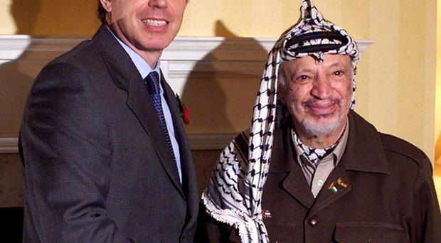 Palestinian president Yasser Arafat, pictured with Tony Blair, died in a French military hospital in 2004