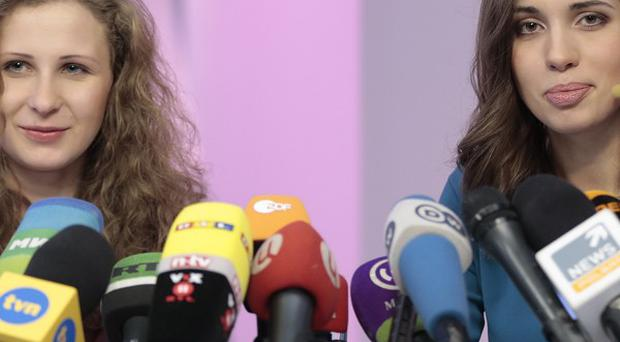 Pussy Riot members Nadezhda Tolokonnikova, right, and Maria Alekhina giving a Moscow news conference after they were granted amnesty (AP)