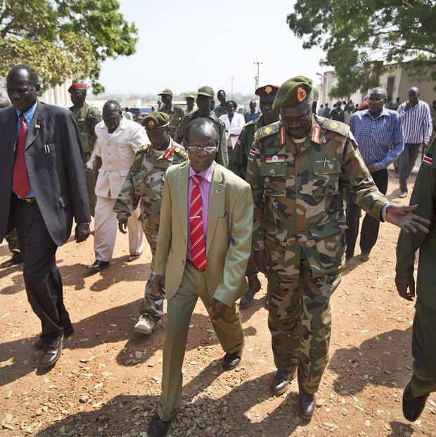 South Sudan's current vice president, James Wani Igga, visits wounded patients at the Juba Military Hospital. (AP)