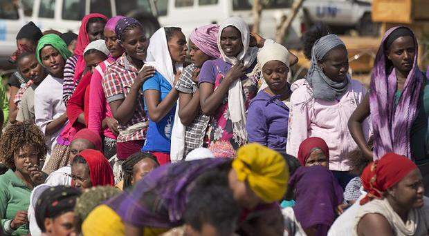 Displaced women queue inside the United Nations camp where they have sought shelter in Malakal, South Sudan. (AP)