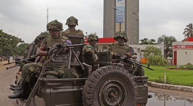 DR Congo soldiers patrol streets as they look for armed assailants in the city of Kinshasa (AP)