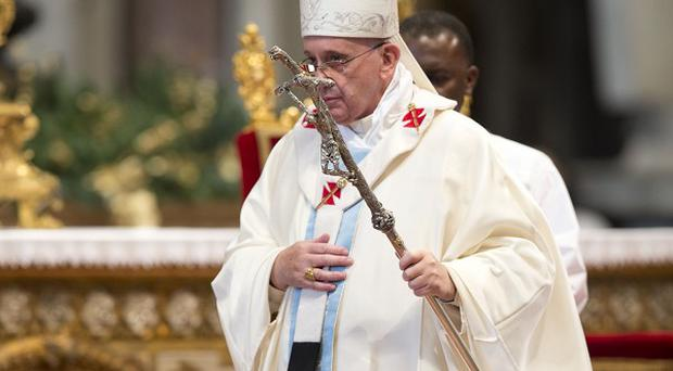 Pope Francis celebrated mass in St Peter's Basilica at the Vatican, calling for an end to violence around the world.