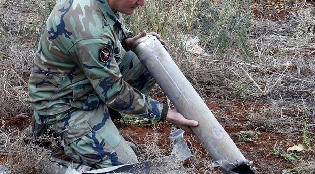 The Lebanese army fired on Syrian aircraft that violated the country's airspace on Tuesday (AP)