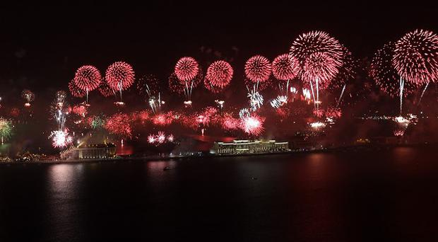 Fireworks explode over the Jumeirah Palm Island to celebrate the New Year (AP)