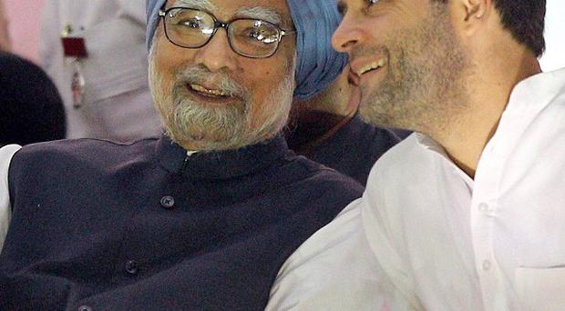 Indian Prime Minister Manmohan Singh, left, wants Rahul Gandhi, right, to succeed him (AP)