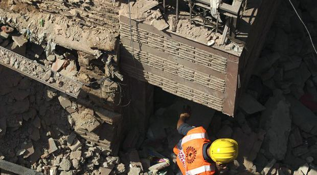 Building collapses are common in India, as demand for housing and lax regulations often encourage builders to cut corners. (AP Photo/Tsering Topgyal)