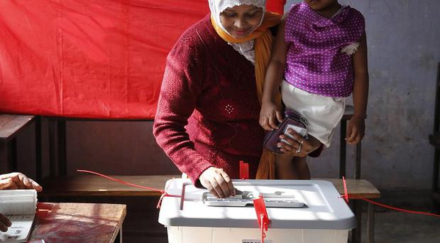 A Bangladeshi woman casts her vote, at a polling station in Dhaka (AP)