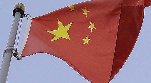 Fourteen people died after a stampede at a mosque in Guyuan, northern China (AP)