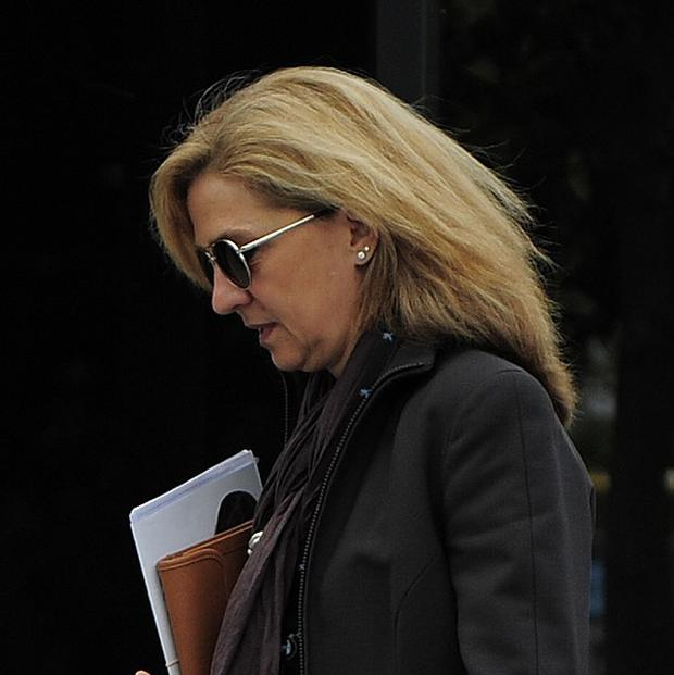 Spain's princess Cristina has been summoned to appear in a fraud case (AP)