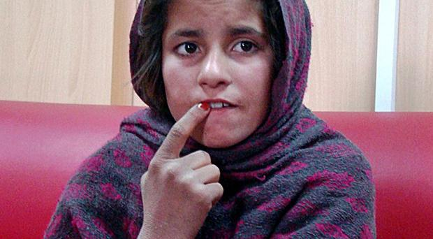 An Afghan girl named Spozhmai told police that her brother, who she said is a Taliban commander, wrapped her in an explosives-packed vest but that she refused to blow herself up (AP Photo)