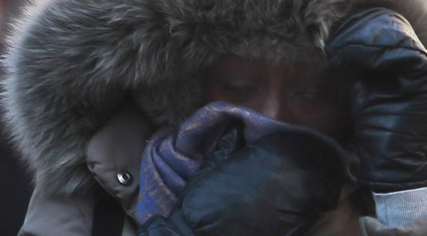 A New York City pedestrian covers up against freezing temperatures.