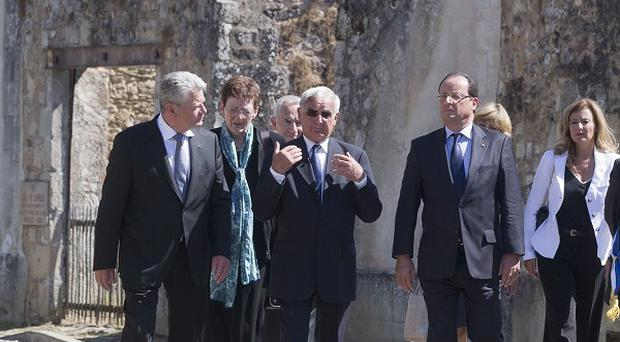 German president Joachim Gauck, and French leader Francois Hollande, in the ghost town of Oradour-sur-Glane in France (AP)
