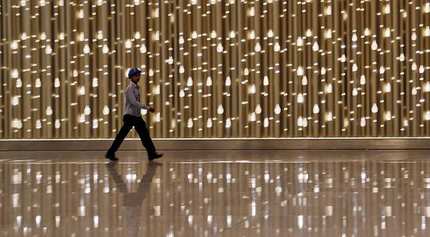 A worker walks inside the new airport terminal in Mumbai, India. (AP)