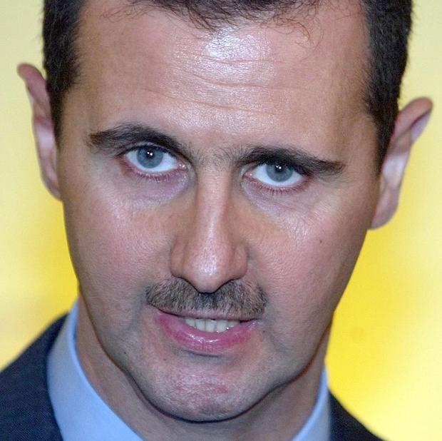 Forces loyal to Syrian president Bashar Assad have killed dozens of rebels in the city of Homs.