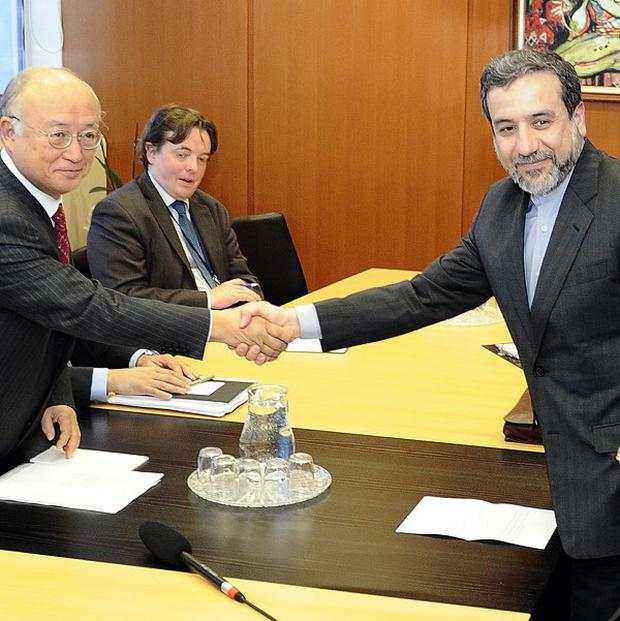 Iran's deputy Foreign Minister Abbas Araghchi, right, shakes hands with Director General of the International Atomic Energy Agency, IAEA, Yukiya Amano before a meeting (AP)