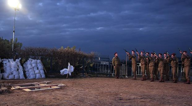 Soldiers rehearse at the grave site where Israeli former prime minister Ariel Sharon will be buried after a memorial ceremony in Jerusalem (AP)