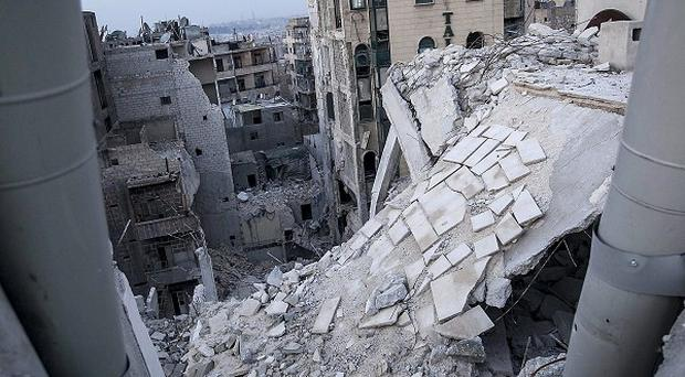 The remains of Dar Al-Shifa hospital in ruins following airstrikes in Aleppo, Syria (AP)