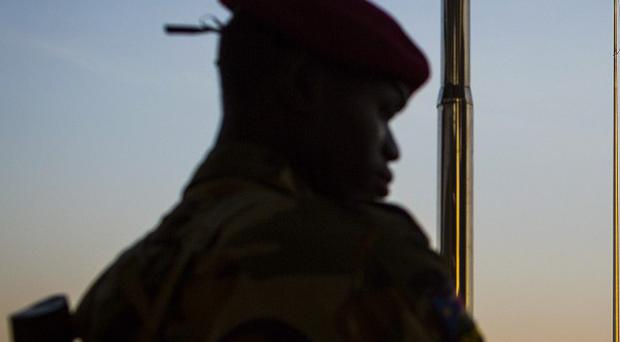 A South-Sudanese soldier stands guard in Juba (AP)