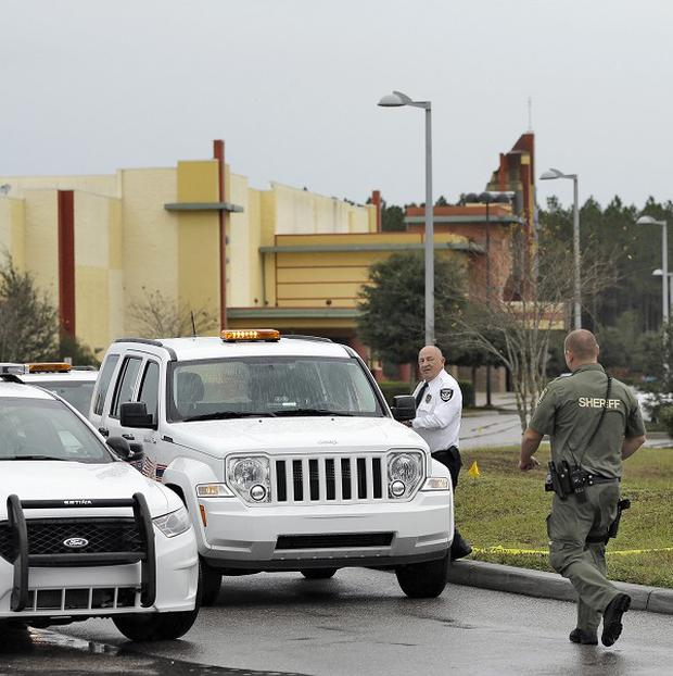 Police surround a Florida cinema where a man was shot dead in a row over phone texting (AP)