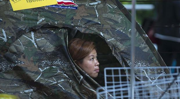 An anti-government activist at the protest camp in the Pathumwan district where shots rang out, wounding two people (AP)
