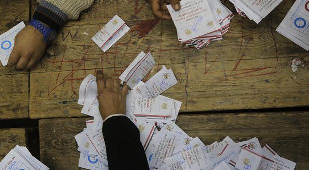 Egyptian election workers count ballots at the end of the second, final day of the referendum on a new constitution (AP)