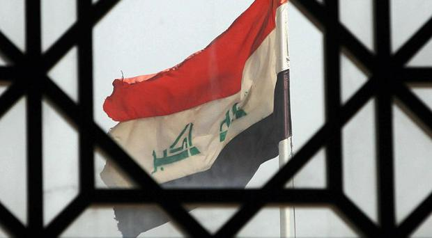 Police in Iraq have found the corpses of 14 Sunni men abducted by gunmen in military uniforms from a town near Baghdad