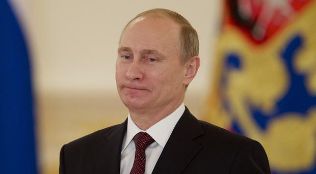 Russian president Vladimir Putin says there will be no discrimination against gays visiting the Sochi winter Olympics (AP)