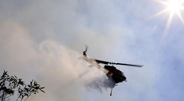 Firefighters are battling scores of blazes in south-east Australia (AP)