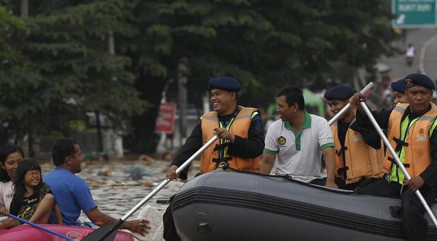 Indonesia has been hit by heavy seasonal rains and high tides in recent days (AP)
