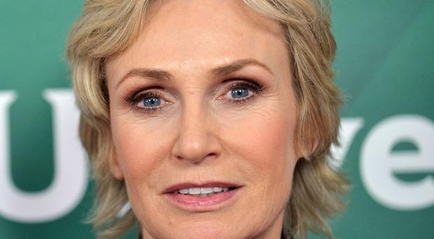 Jane Lynch is hosting a celebrity game show (Invision/AP)