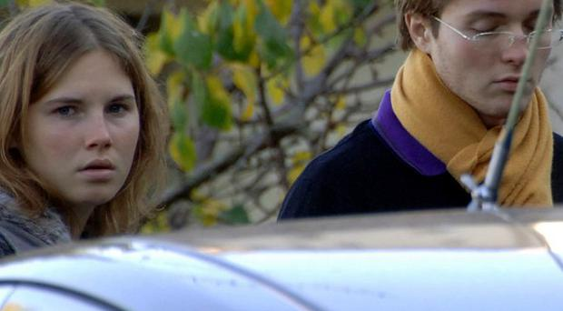 Amanda Knox and Raffaele Sollecito outside the rented house where Meredith Kercher was found dead in Perugia (AP)