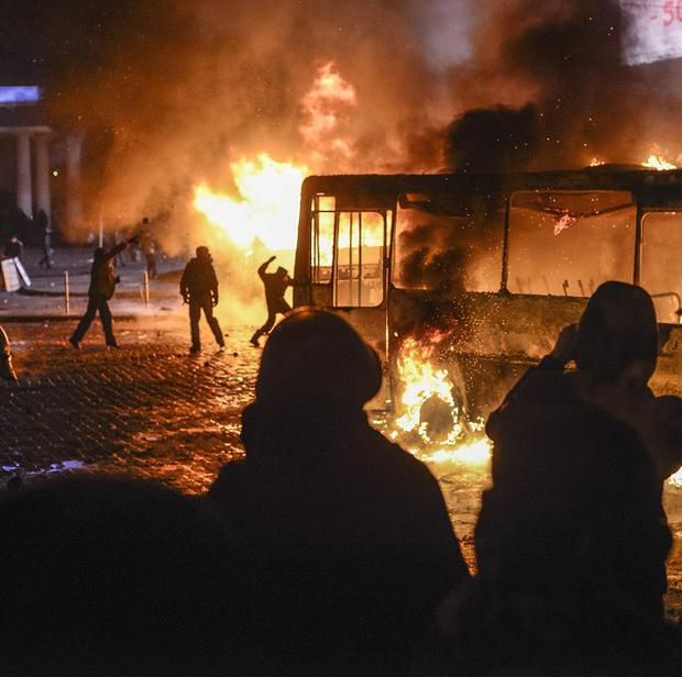 Anti-government protests in the Ukraine have escalated into fiery street battles with police as thousands of demonstrators hurled rocks and fire bombs. (AP)
