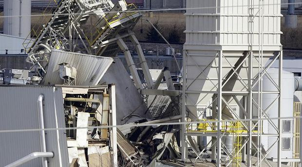 The International Nutrition plant is shown with wreckage in Omaha, Nebraska, following a fire and explosion (AP)