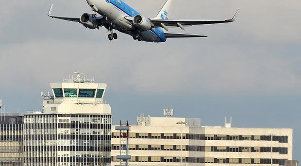 A KLM Boeing 737-800 takes off from Manchester Airport.