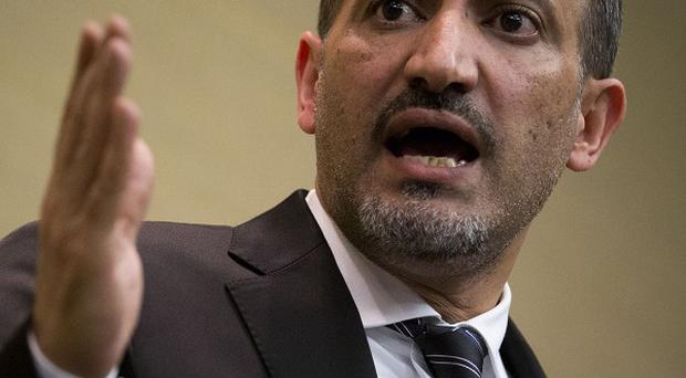 Ahmad al-Jarba, leader of Syria's main political opposition group, says the negotiations will be difficult (AP)